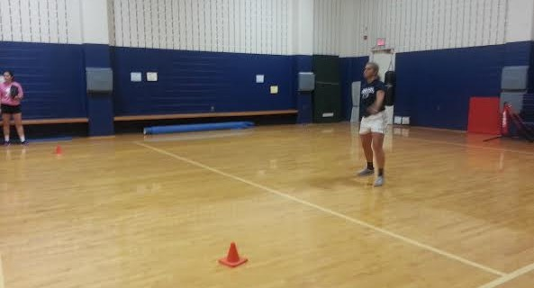 Freshman Lindsey Dellavecchio takes some ground balls during practice in the auxiliary gym.