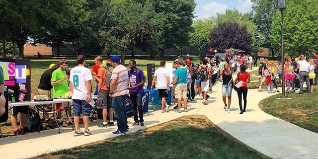 Photo by: Brooke Byrne. Students visit tables for more information on the clubs that spark their interest