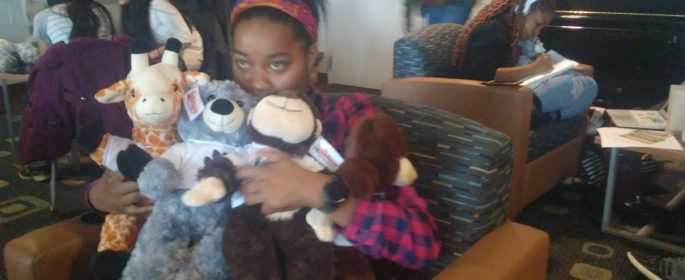 "Feshman student, Tayna cuddling a few of the stuff animals the event had to offer. ""I'm giving my stuffed animals to my niece, everyone got love.""  In a few days, the stuff animals will be given away to the people that she loves."