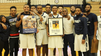 Turner (in middle) stands with his team on his last home game ever for senior night