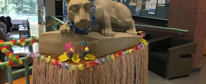 The Lion Shrine in Tomezsko was all dressed up in a PSU blue and white lei for the luau.